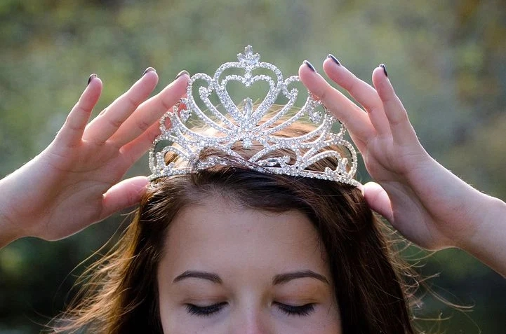 A girl wearing her crown