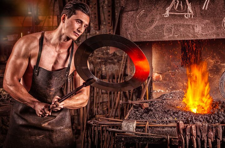 A blacksmith working hard to earn a living