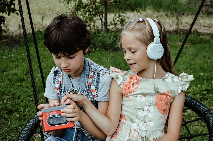 2 Children listening to music