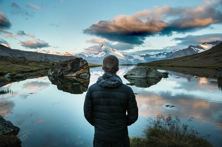 A man standing still an gazing at the sky