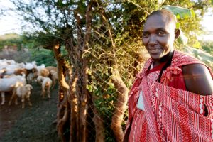Maasai woman standing next to a Living Wall