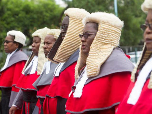 Zimbabwean judges in long red robes and horsehair wigs, a throwback to an era of British Colonial rule
