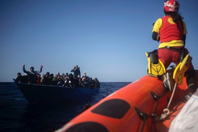 Rescue ship with 265 migrants anchors off Italy