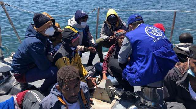 At least five people, including a woman and a child, drowned when a boat carrying at least 45 Europe-bound migrants capsized off Libya, a U.N. migration official said