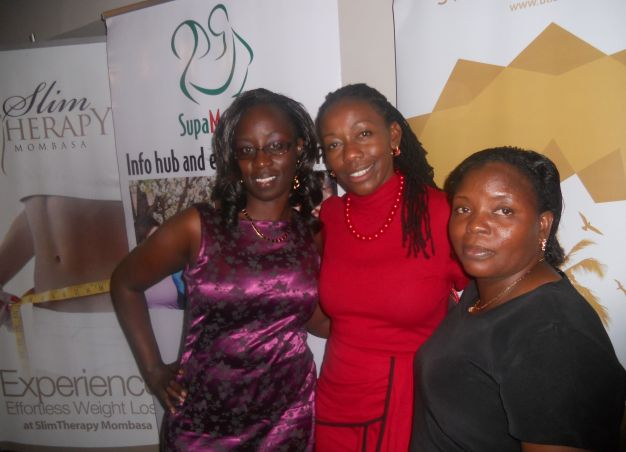 Christine (centre) poses for photos with some of her admirers during a recent Supamamas event in Mombasa