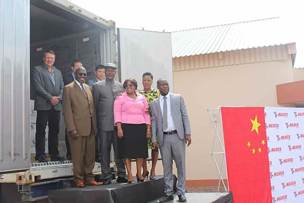 Dignitaries at the truck of premium beef off to China