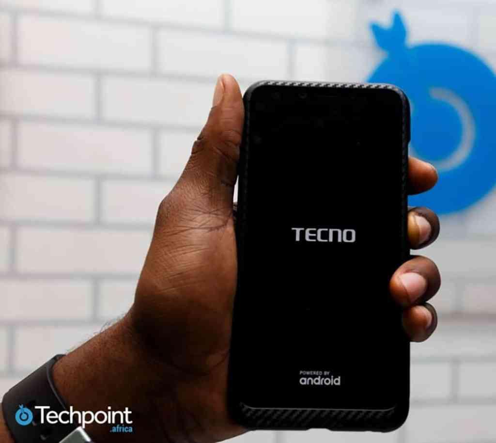 Hand holding Tecno phone