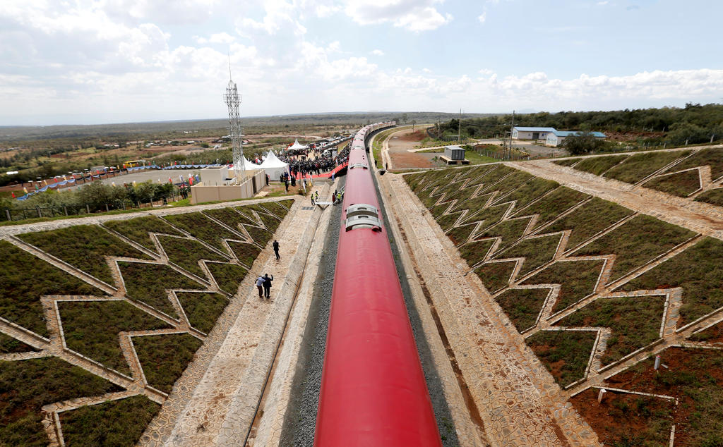 An aerial view shows a train on the Standard Gauge Railway (SGR) line constructed by the China Road and Bridge Corporation (CRBC) and financed by Chinese government in Kimuka, Kenya October 16, 2019. REUTERS/Thomas Mukoya/File Photo