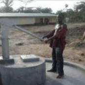 Man at well in liberia nimba
