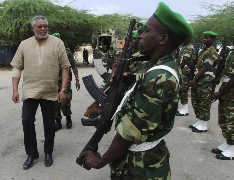 Jerry Rawlings inspects troops in 2011.(Associated Press)