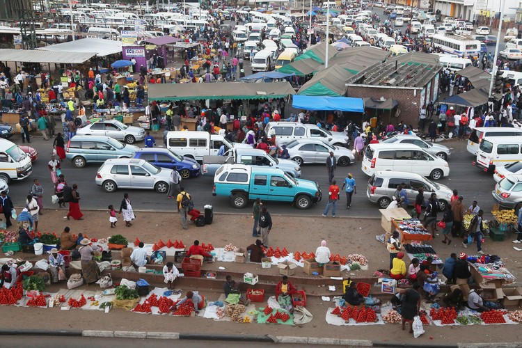 Street vendors trade their goods in Harare Central Business District. They are among thousands of informal traders in Zimbabwe who are forced to bribe municipal police to avoid arrests or their goods being confiscated. Photo: Believe Nyakudjara