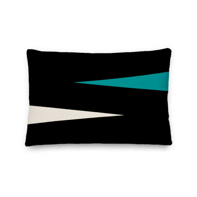 black lumbar pillow with teal triangles shards of color teal