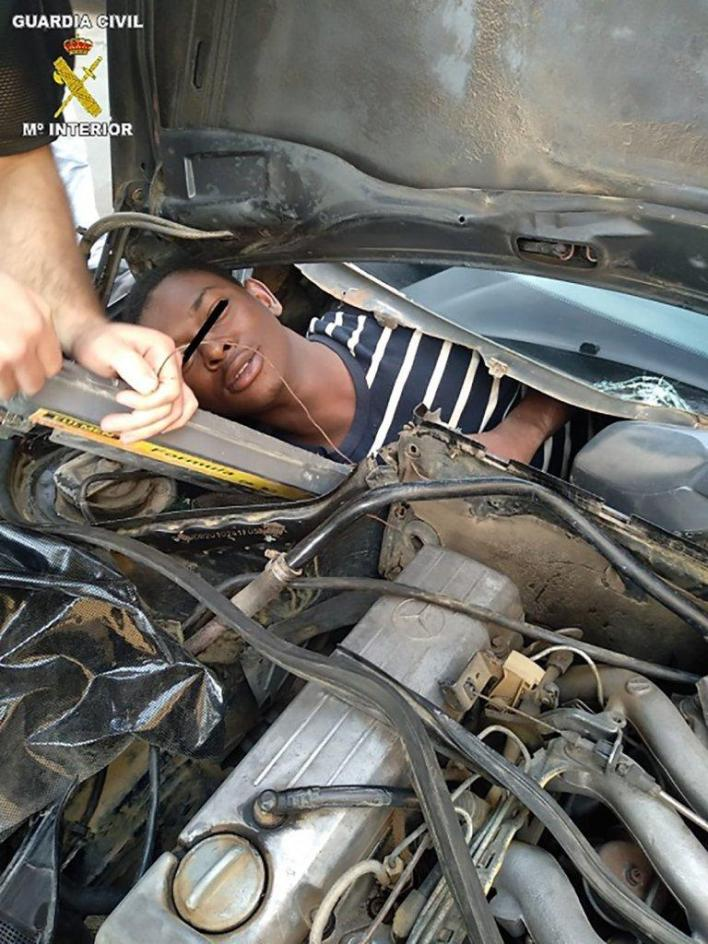 4 migrants squeezed in rear seats, car hood to escape from Morocco