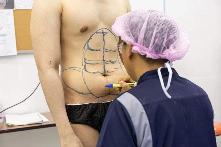 Don't feel like exercising? Thai clinic introduces instant six-pack