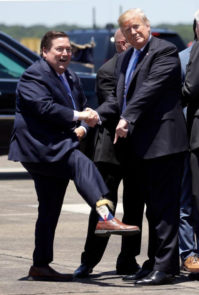 Deputy Governor greets American President with bizarre (hairy) Trump socks