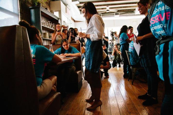 Alexandria Ocasio-Cortez serves cocktails for $2.13 an hour