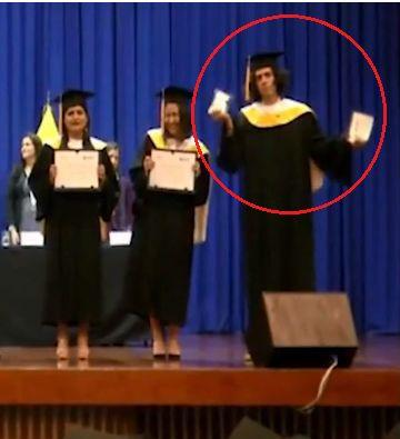 Young man destroys his diploma during graduation ceremony [Video]