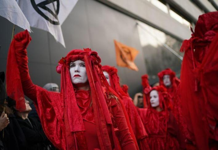 Climate activists hijack London fashion week