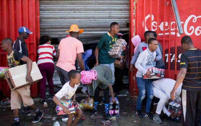 Children are seen in the looting of the shop