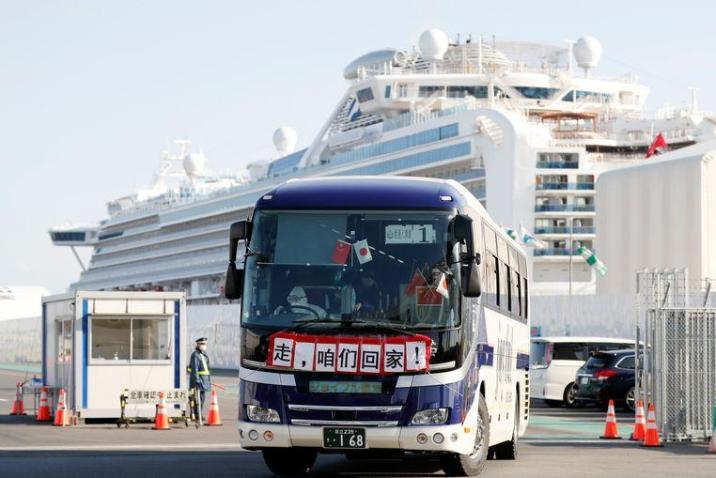 A bus with passengers who were allowed to leave the Diamond Princess