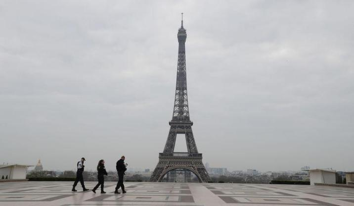 Only three officers populate the Esplanade du Trocadero, the square in front of the Eiffel Tower in Paris.