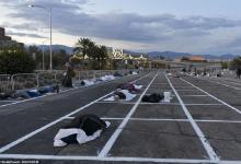 "Open-air car park in Las Vegas becomes temporary homeless shelter ""while 150,000 hotel rooms are empty"""
