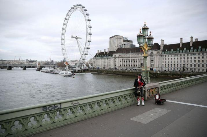This bagpipe player is brave at an empty Westminster Bridge in London.