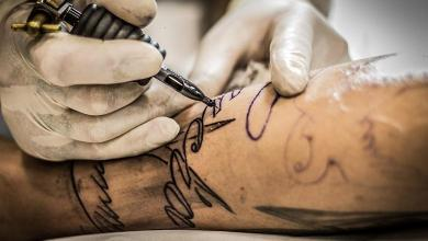 American tattoo artist removes racist tattoos for free