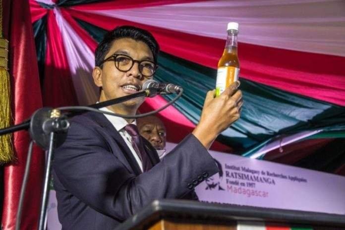 President of Madagascar, Andry Rajoelina with a dose of Covid-Organics