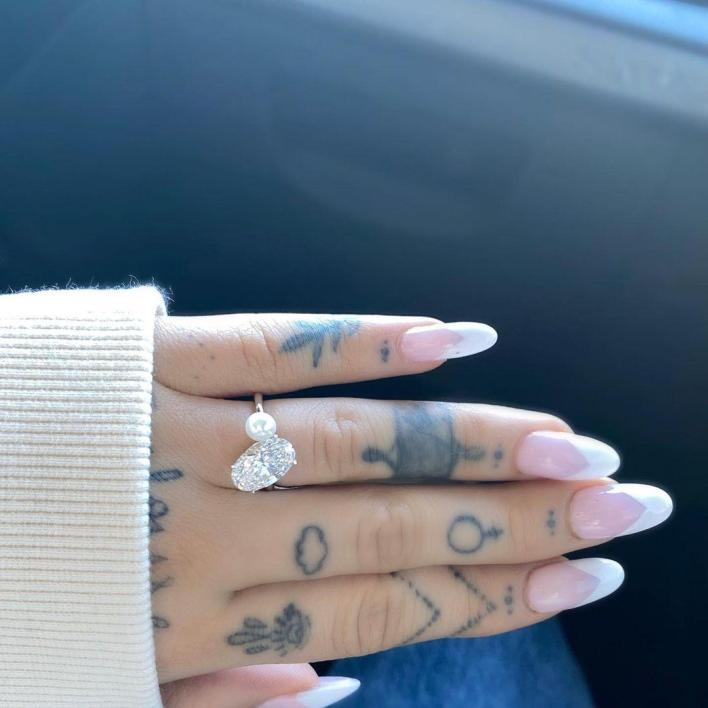 a photo of her diamond engagement ring, which she received from her boyfriend, Dalton Gomez