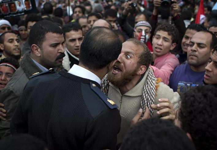 In Egypt, around 1,000 people died due to mass protests that were accompanied by clashes with the police. Pictured: A protester argues with a policeman in Tahrir Square in Cairo, February 13, 2011.