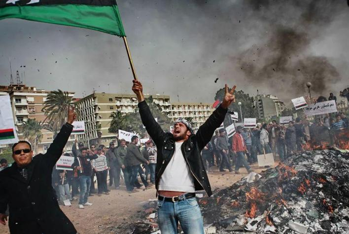 From Tunisia, the wave of unrest spread to Algeria, Jordan, Egypt, and Yemen, and then to other countries. Pictured: Benghazi's residents, <a href=