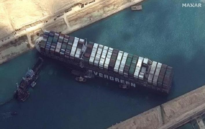 Stuck ship in Suez Canal may already be loose tonight