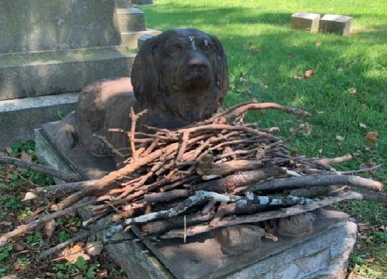 Why for over 100 years people still bringing wooden sticks to dog's grave in Brooklyn