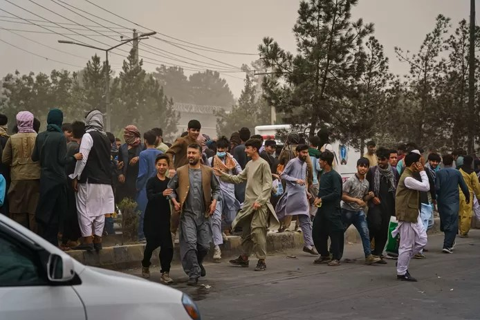 Taliban fighters attack crowds with firearms, whips, and sticks