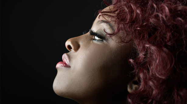Close-Up-Portrait-Of-Beautiful-Black-Woman-On-Black-Background-With-Red-Hair-on-Shutterstock