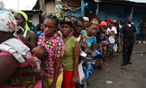 Liberians in Monrovia queuing for food rations. Photo credit Ahmed Jallanzo EPA