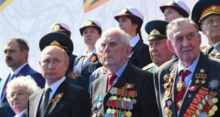 Russian parade defies pandemic as Putin stages power bid without wearing face mask
