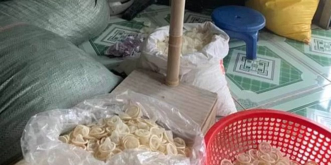 Police seize 324000 used condoms as they bust factory repackaging them and selling back to the public (photos)