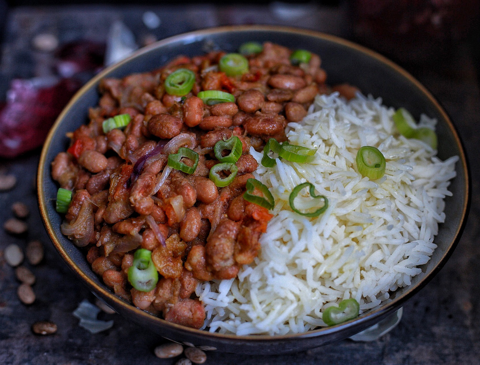 Stewed pinto beans served with basmati rice