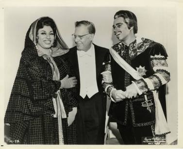 "Soprano Leontyne Price, conductor Karl Bohm, and George Shirley posing during a production of Mozart's ""Don Giovanni,"" 1966-67. Printed on front: ""Louis Melancon, Metropolitan Opera, New York City."""
