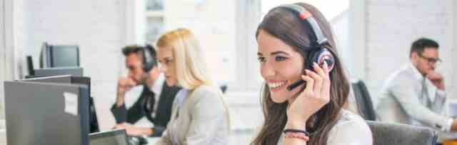 A Female Freight Dispatcher Smiling With a Headset on Her Head