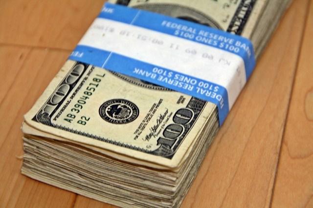 A stack of $100 dollar bills
