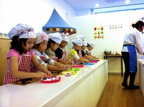 cooking lesson at the kid's cafe.