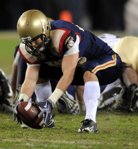 Navy outside linebacker Craig Schaefer scoops up an Army fumble in the fourth quarter setting up Ricky Dobbs touchdown to put the game out of reach for Army.