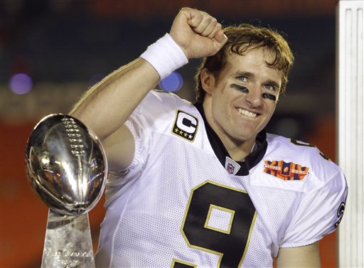 New Orleans Saints quarterback Drew Brees celebrates with the Vince Lombardi Trophy after winning Super Bowl XLIV against Indianapolis on Sunday. (AP Photo/Julie Jacobson)