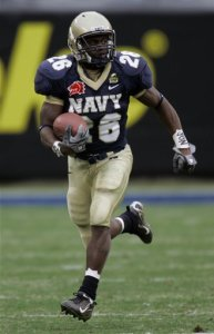 Shun White, seen playing for Navy during the Meineke Car Care Bowl in Dec. 2006, is under contract with the New England Patriots. (AP Photo/Chuck Burton)