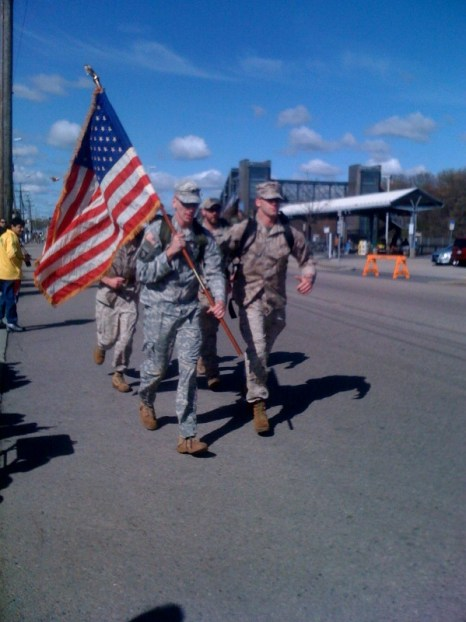 Soldiers and Marines participate Monday in the 114th running of the Boston Marathon. Above, the service members pass the Framingham railroad station, in background on right, near Mile 6. (Mariah Walters Edmonds // Staff)