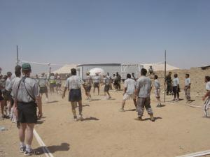 "Soldiers from the 1st Infantry Division, ""Big Red One,"" go against the Iraqi police at a July 4, 2004, volleyball game in Bayji, Iraq."