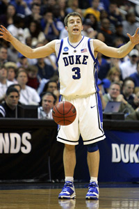 Navy basketball coach Billy Lange hired former Duke point guard Greg Paulus onto his staff Tuesday.